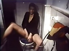 lady choking snake on water closet