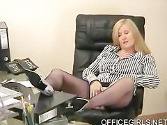 bulky secretary teases in the office in blue silk